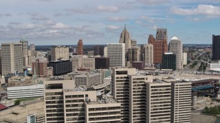 DX0002_189_012 - 5.7K stock footage aerial video fly away skyline, reveal apartment towers, Downtown Detroit, Michigan