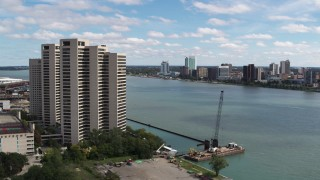DX0002_189_014 - 5.7K stock footage aerial video the Windsor, Ontario skyline across the river, seen from Downtown Detroit, Michigan