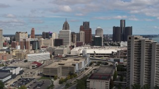 DX0002_189_019 - 5.7K stock footage aerial video a view of the skyline during descent, Downtown Detroit, Michigan