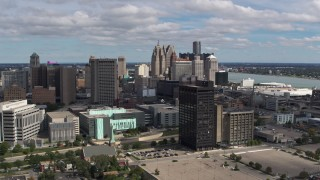DX0002_189_028 - 5.7K stock footage aerial video flying by office buildings with a view of the skyline, Downtown Detroit, Michigan