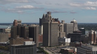 DX0002_189_041 - 5.7K stock footage aerial video of the Patrick V. McNamara Federal Building and skyscrapers, Downtown Detroit, Michigan