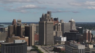 DX0002_189_042 - 5.7K stock footage aerial video passing by the Patrick V. McNamara Federal Building and skyscrapers, Downtown Detroit, Michigan