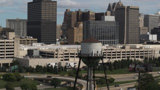 DX0002_189_044 - 5.7K stock footage aerial video of orbiting a water tower in Downtown Detroit, Michigan