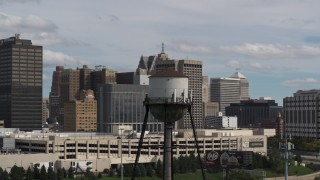 DX0002_189_045 - 5.7K stock footage aerial video of circling a water tower in Downtown Detroit, Michigan