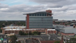DX0002_190_001 - 5.7K stock footage aerial video of ascending past MotorCity Casino Hotel in Detroit, Michigan
