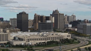 DX0002_190_003 - 5.7K stock footage aerial video ascend past hotel with view of skyscrapers, Downtown Detroit, Michigan
