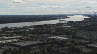 DX0002_190_005 - 5.7K stock footage aerial video of the Ambassador Bridge spanning the Detroit River, Detroit, Michigan