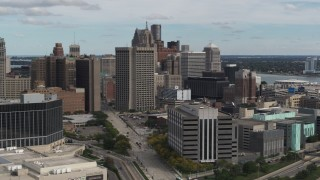 DX0002_190_008 - 5.7K stock footage aerial video view of federal building while flying by hotel, Downtown Detroit, Michigan