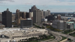 DX0002_190_009 - 5.7K stock footage aerial video fly away from federal building and hotel, Downtown Detroit, Michigan