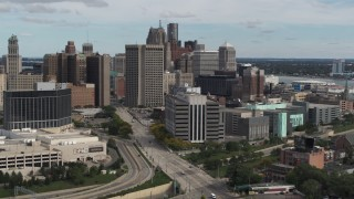 DX0002_190_010 - 5.7K stock footage aerial video flyby and approach a federal building and skyscrapers, Downtown Detroit, Michigan