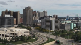 DX0002_190_012 - 5.7K stock footage aerial video of orbiting police headquarters, Downtown Detroit, Michigan