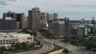 DX0002_190_015 - 5.7K stock footage aerial video of circling the downtown police headquarters, Downtown Detroit, Michigan