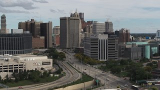 DX0002_190_016 - 5.7K stock footage aerial video fly away from downtown police headquarters and descend, Downtown Detroit, Michigan