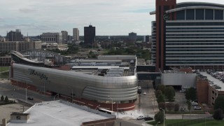 DX0002_190_025 - 5.7K stock footage aerial video closely orbiting the MotorCity Casino Hotel near Downtown Detroit, Michigan