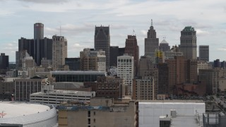 DX0002_190_035 - 5.7K stock footage aerial video ascend over rooftops for view of the city's skyline, Downtown Detroit, Michigan