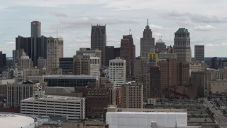 DX0002_190_037 - 5.7K stock footage aerial video a view over rooftops of the city's skyline, Downtown Detroit, Michigan
