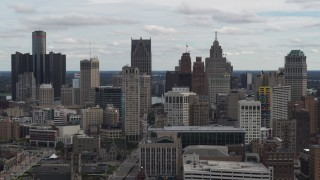 DX0002_190_039 - 5.7K stock footage aerial video ascend and flyby the city's downtown skyline, Downtown Detroit, Michigan