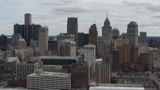 DX0002_190_042 - 5.7K stock footage aerial video the city's downtown skyline seen while descending near arena, Downtown Detroit, Michigan