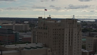 DX0002_190_043 - 5.7K stock footage aerial video orbit the top of the Detroit Masonic Temple building, Detroit, Michigan