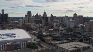 DX0002_191_007 - 5.7K stock footage aerial video flying by baseball and football stadiums with view of skyline, Downtown Detroit, Michigan