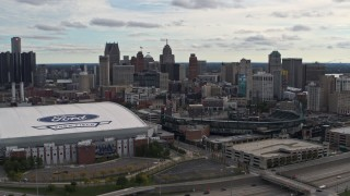 DX0002_191_008 - 5.7K stock footage aerial video flying by football and baseball stadiums with view of skyline, Downtown Detroit, Michigan