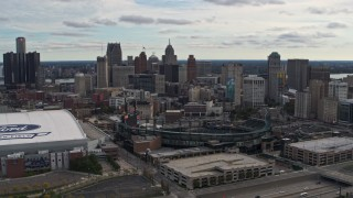 DX0002_191_009 - 5.7K stock footage aerial video flying by Comerica Park with view of skyline, reveal Ford Field, Downtown Detroit, Michigan
