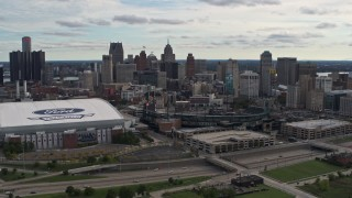 DX0002_191_010 - 5.7K stock footage aerial video the skyline behind Ford Field and Comerica Park stadiums, Downtown Detroit, Michigan