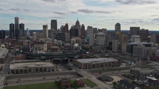 DX0002_191_011 - 5.7K stock footage aerial video the skyline behind Comerica Park stadium, Downtown Detroit, Michigan