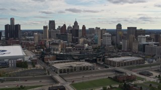 DX0002_191_013 - 5.7K stock footage aerial video a reverse view of Comerica Park baseball stadium and skyline, Downtown Detroit, Michigan