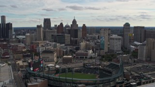 DX0002_191_014 - 5.7K stock footage aerial video of approaching Comerica Park baseball stadium and skyline, Downtown Detroit, Michigan