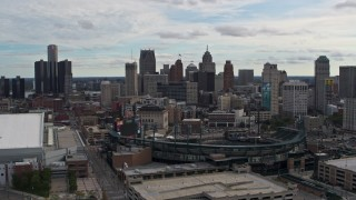 DX0002_191_018 - 5.7K stock footage aerial video descend with view of baseball stadium and skyline, Downtown Detroit, Michigan