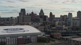 DX0002_191_022 - 5.7K stock footage aerial video of the downtown skyline while passing by baseball and football stadiums, Downtown Detroit, Michigan