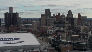 DX0002_191_026 - 5.7K stock footage aerial video focus on downtown skyline while passing Ford Field and Comerica Park, Downtown Detroit, Michigan