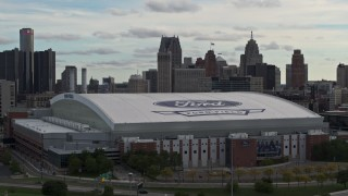 DX0002_191_029 - 5.7K stock footage aerial video focus on downtown skyline while ascending past Ford Field, Downtown Detroit, Michigan