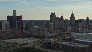 DX0002_191_036 - 5.7K stock footage aerial video slow flyby of the city's skyline at sunset in Downtown Detroit, Michigan