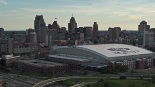 DX0002_191_040 - 5.7K stock footage aerial video of the football stadium and the city skyline at sunset in Downtown Detroit, Michigan
