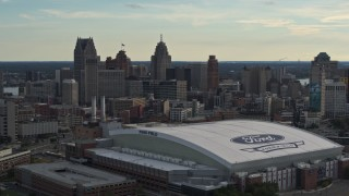 DX0002_191_045 - 5.7K stock footage aerial video flyby Ford Field football stadium and the city skyline at sunset in Downtown Detroit, Michigan