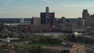 DX0002_191_050 - 5.7K stock footage aerial video flyby tall skyscrapers and a hotel at sunset before ascending in Downtown Detroit, Michigan