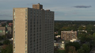 DX0002_192_001 - 5.7K stock footage aerial video of the City Place Detroit apartment building at sunset, Detroit, Michigan