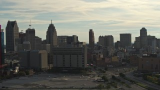 DX0002_192_005 - 5.7K stock footage aerial video flyby the city skyline at sunset, descend with view of courthouse, Downtown Detroit, Michigan