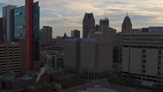 DX0002_192_023 - 5.7K stock footage aerial video of an orbit of the Wayne County Jail Division 1 building at sunset, Downtown Detroit, Michigan