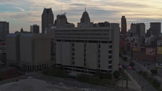 DX0002_192_025 - 5.7K stock footage aerial video of orbiting Frank Murphy Hall of Justice courthouse at sunset, Downtown Detroit, Michigan