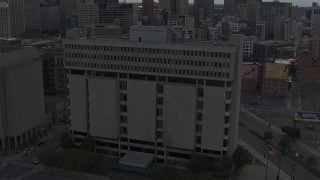 DX0002_192_026 - 5.7K stock footage aerial video of an orbit of Frank Murphy Hall of Justice at sunset, Downtown Detroit, Michigan