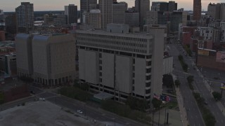 DX0002_192_029 - 5.7K stock footage aerial of the Frank Murphy Hall of Justice while descending at sunset, Downtown Detroit, Michigan