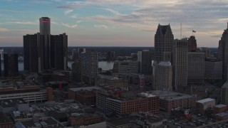 DX0002_192_036 - 5.7K stock footage aerial video of flying by skyscrapers at sunset to reveal a hotel, Downtown Detroit, Michigan