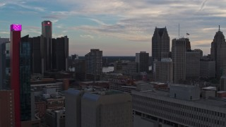 DX0002_192_037 - 5.7K stock footage aerial video flyby a hotel at sunset and focus on the city's skyscrapers, Downtown Detroit, Michigan