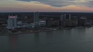 DX0002_192_049 - 5.7K stock footage aerial video the city's skyline across the Detroit River, Windsor, Ontario, Canada, sunset