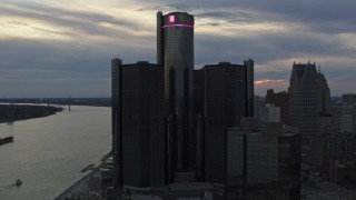 DX0002_192_050 - 5.7K stock footage aerial video circling the GM Renaissance Center skyscraper at sunset, Downtown Detroit, Michigan