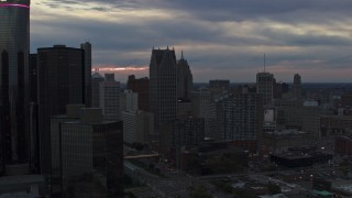 DX0002_192_052 - 5.7K stock footage aerial video of skyscrapers at sunset, reveal GM Renaissance Center, Downtown Detroit, Michigan