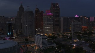 DX0002_193_001 - 5.7K stock footage aerial video of orbiting tall skyscrapers at twilight, Downtown Detroit, Michigan